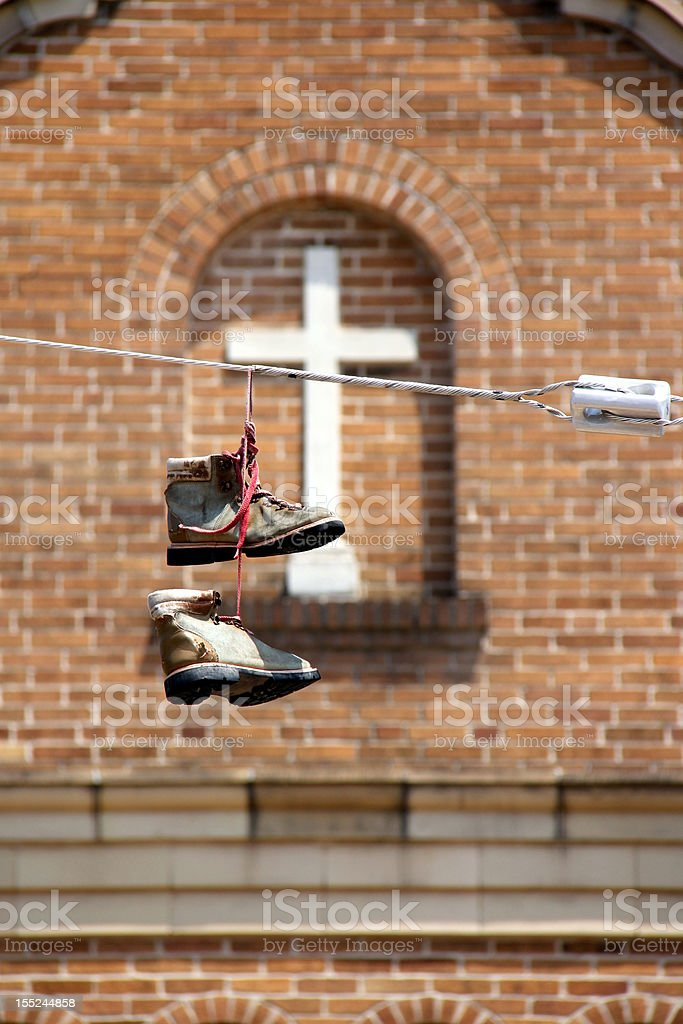 Boots on a Power Line stock photo