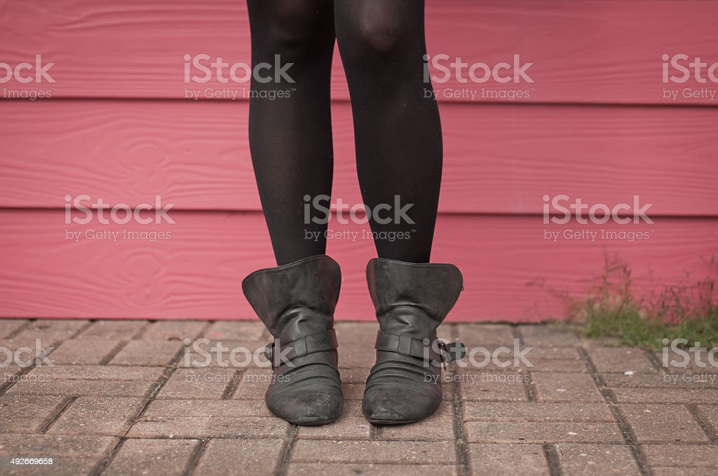 Boots Red wall stock photo
