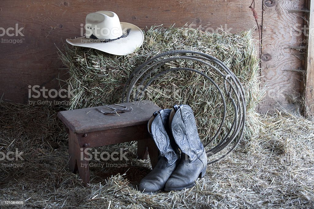 Boots, rope, and hat. royalty-free stock photo