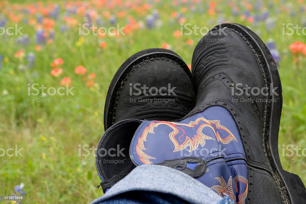 boots & wildflowers royalty-free stock photo
