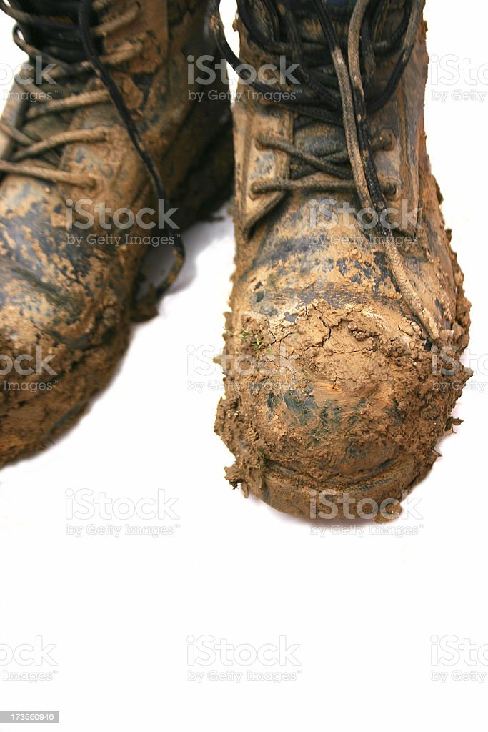 Boots with mud on royalty-free stock photo
