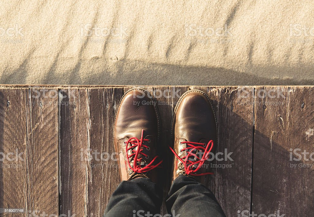 Boots with red shoelaces from above stock photo