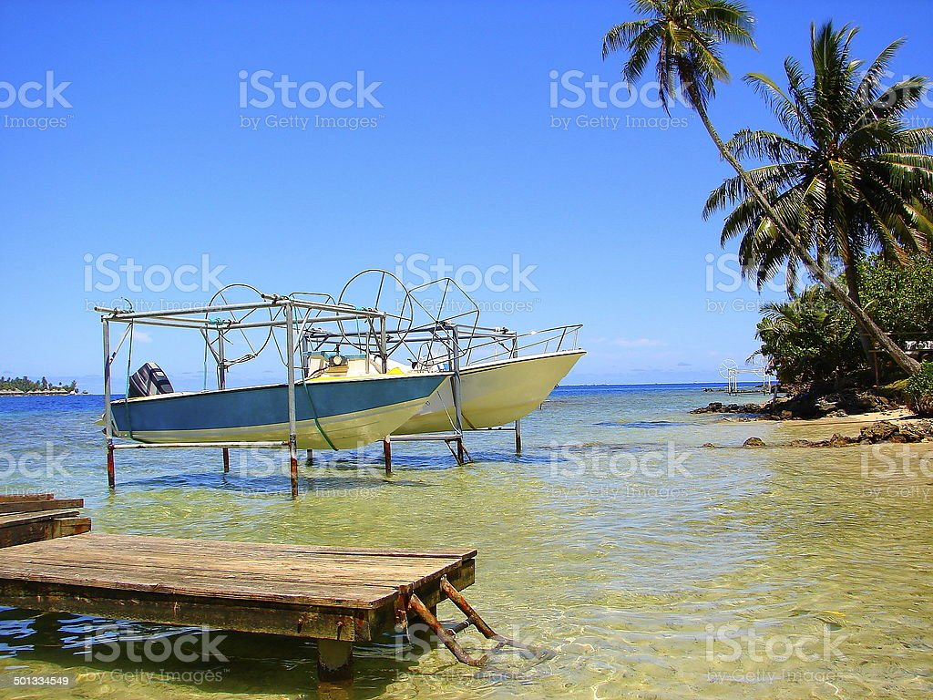 Bora Bora Bungalows and boats pier on turquoise beach, Polynesia royalty-free stock photo