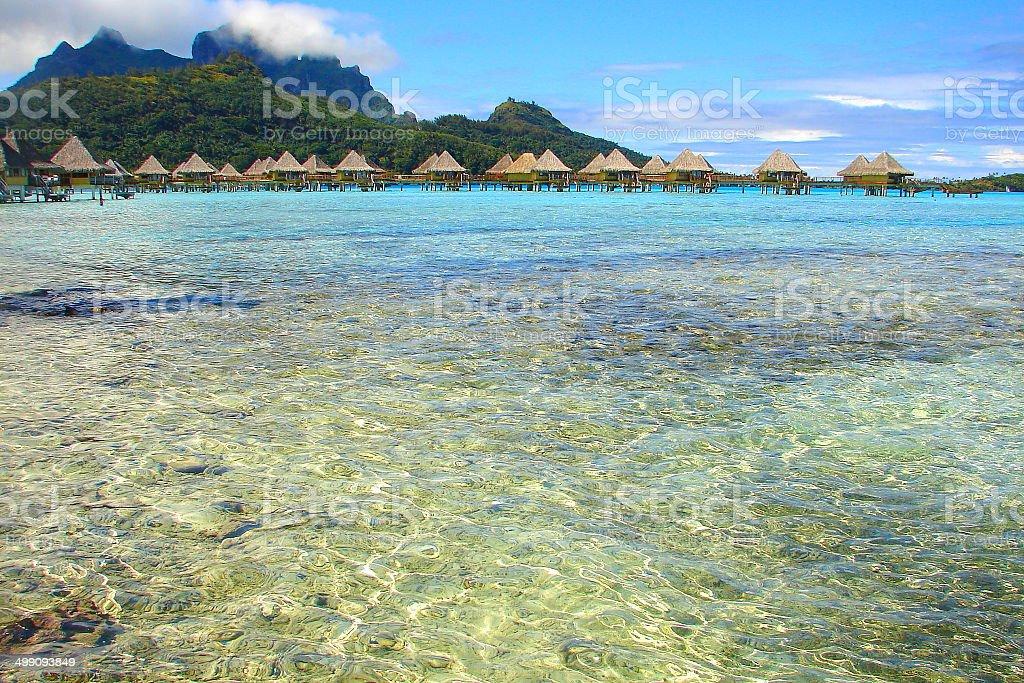 Bora Bora Bungalows over turquoise beach, Polynesia, Tahiti royalty-free stock photo