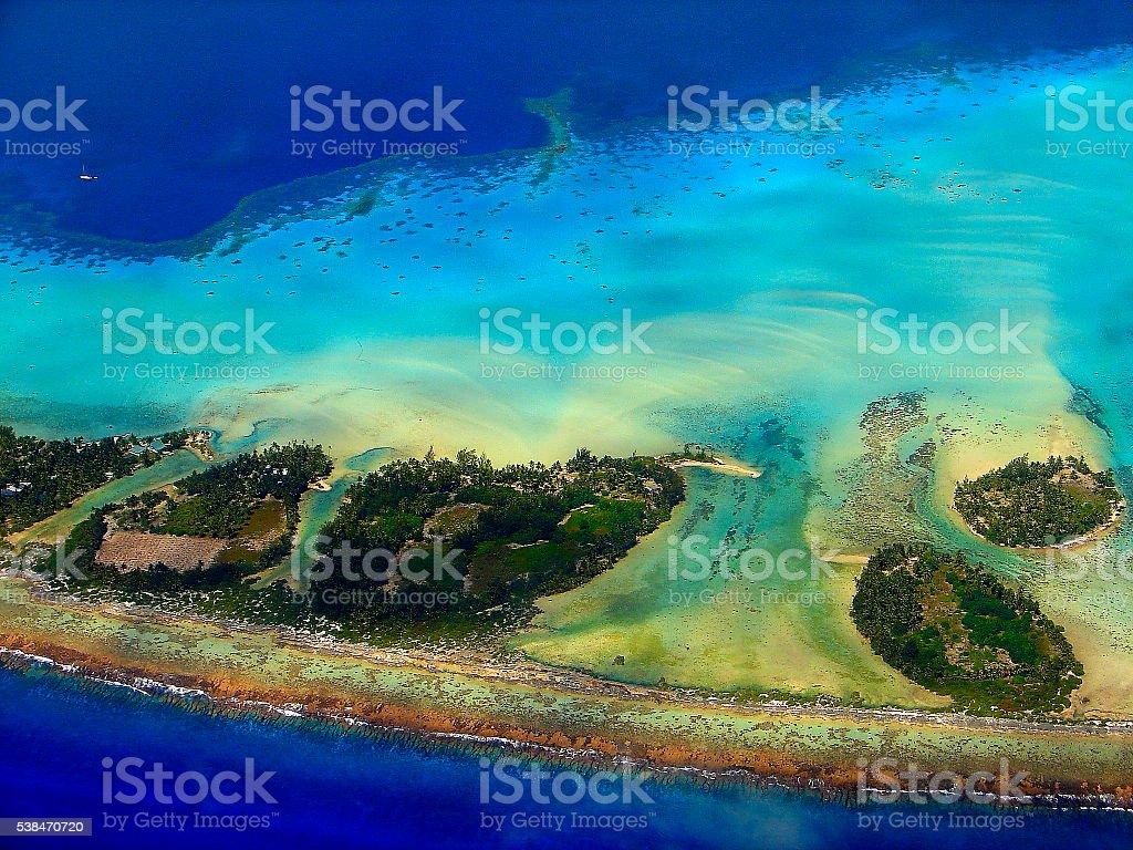 Bora Bora motus, yacht, Polynesia paradise beaches from above, Tahiti stock photo