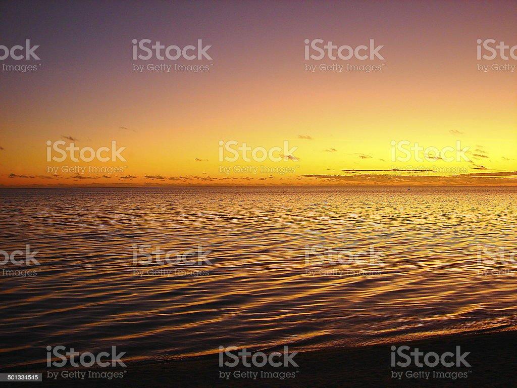 Bora Bora Turquoise beach at golden sunset, French Polynesia, Tahiti royalty-free stock photo