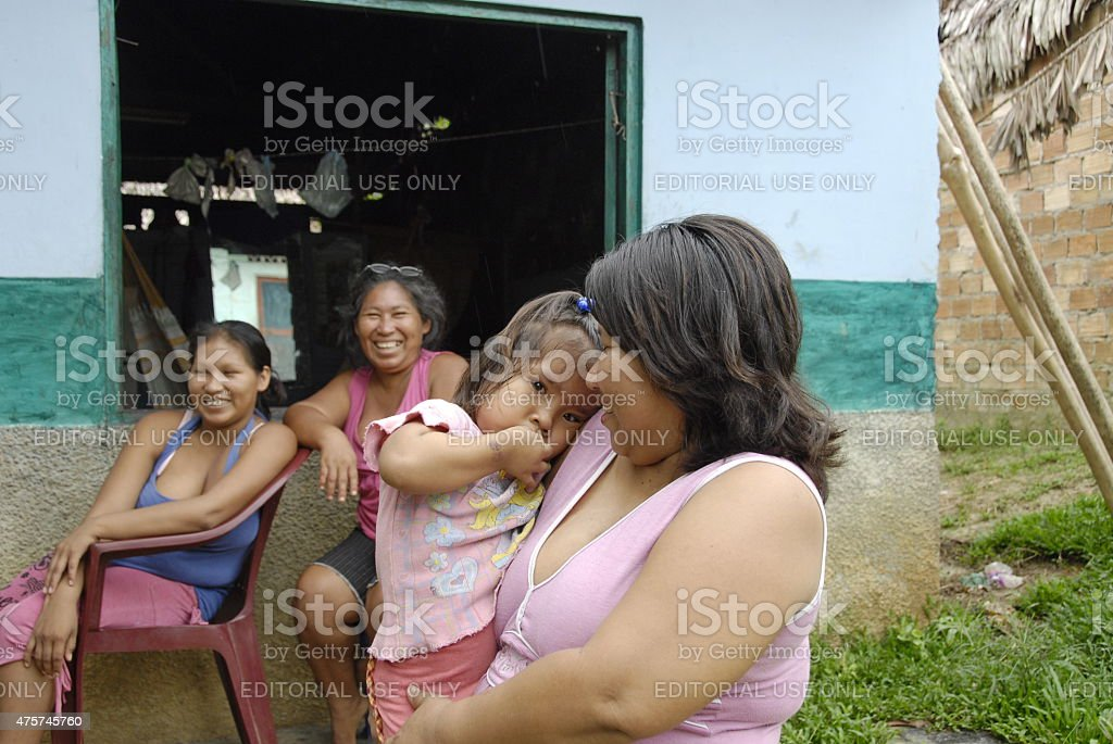 Bora girl with her mother in Padre Cocha, Iquitos, Peru. stock photo
