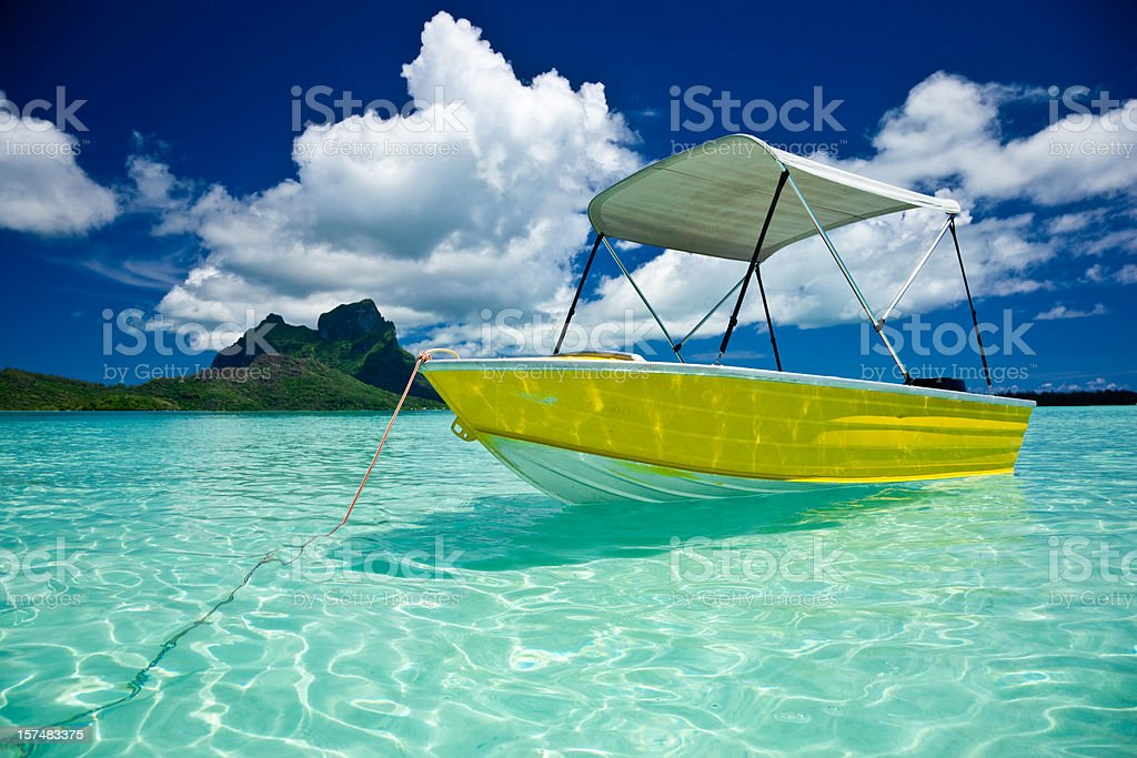 Bora-Bora Idyllic Lagoon with Motor Boat royalty-free stock photo