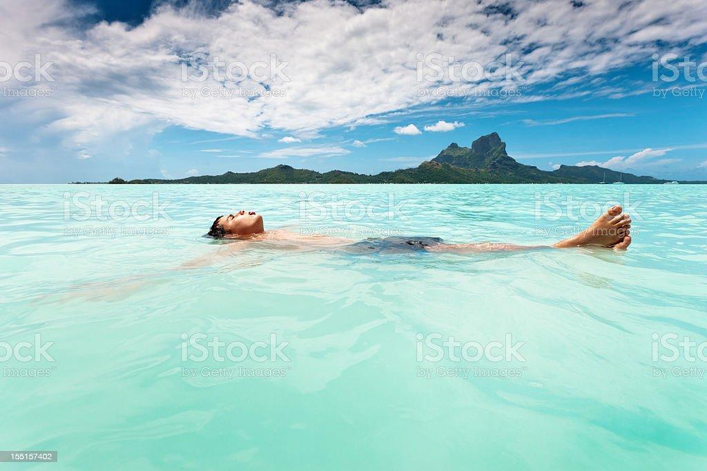 Bora-Bora Island Boy relaxing in South Pacific Ocean Lagoon royalty-free stock photo