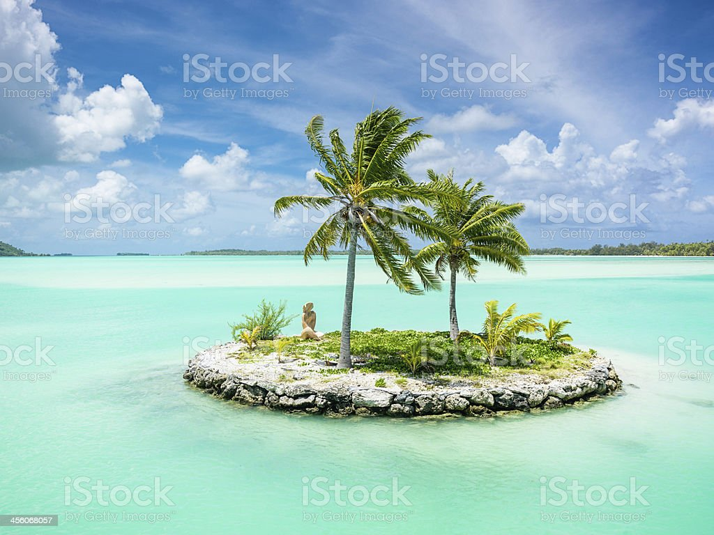 Bora-Bora Lagoon Islet Tiki Statue Welcome Sign stock photo