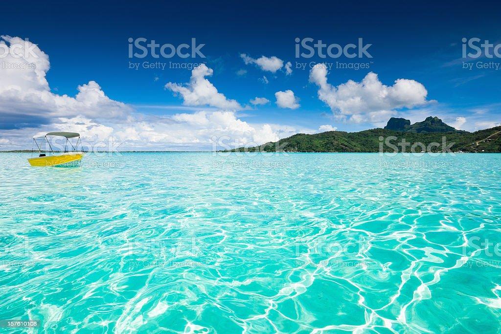 Bora-Bora Lagoon Yellow Motor Boat royalty-free stock photo