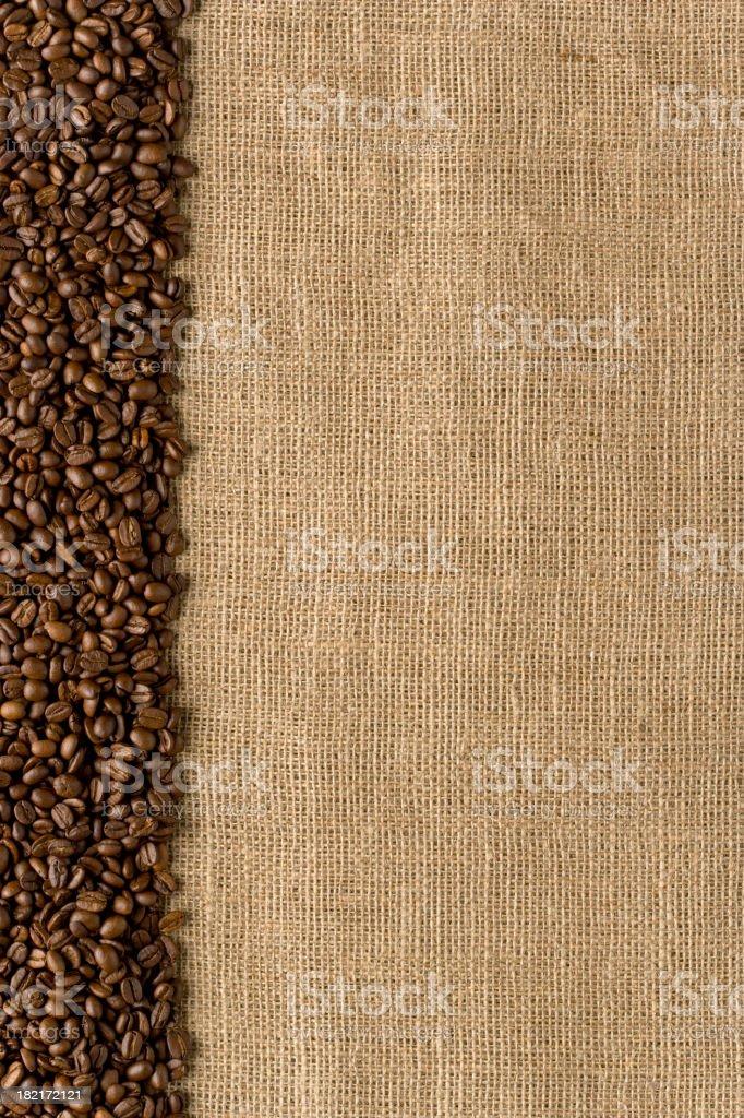 Border - Coffee Beans on Burlap Bag. Full Frame. Vertical royalty-free stock photo