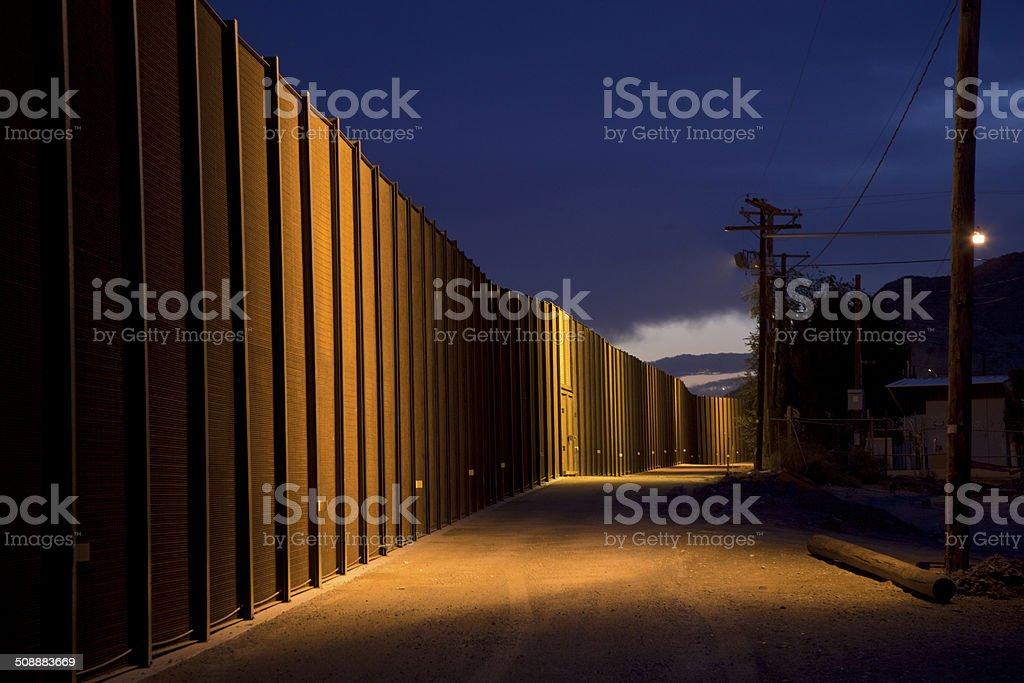 U.S. Border Fence at Night royalty-free stock photo