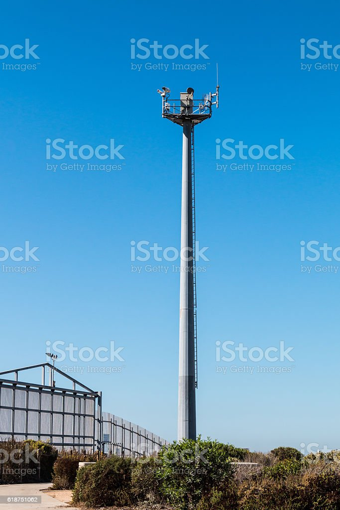 Border Fence Separating San Diego and Tijuana with Security Tower stock photo