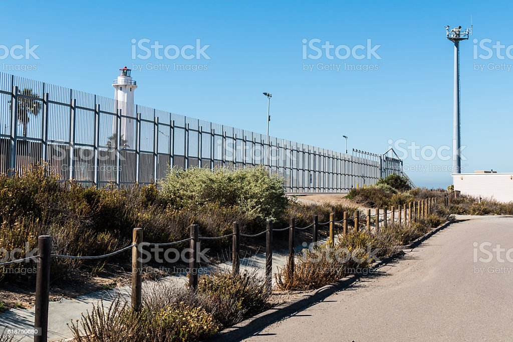 Border Fence with Lighthouse and Security Tower stock photo