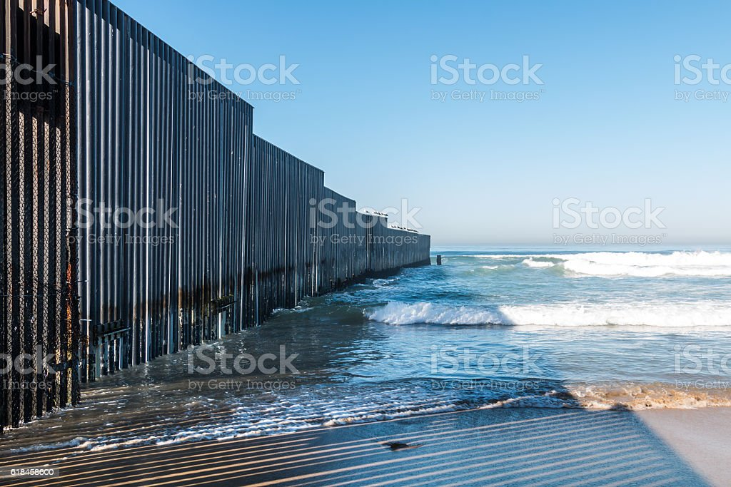 Border Field State Park Beach with International Border Wall stock photo