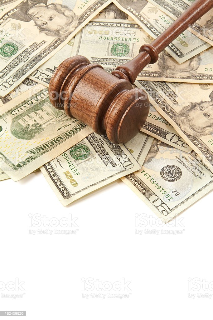 Border: gavel laying on top of money isolated royalty-free stock photo