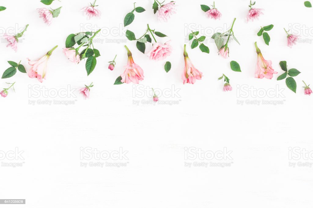 Flowers composition. Border made of pink flowers on white background....