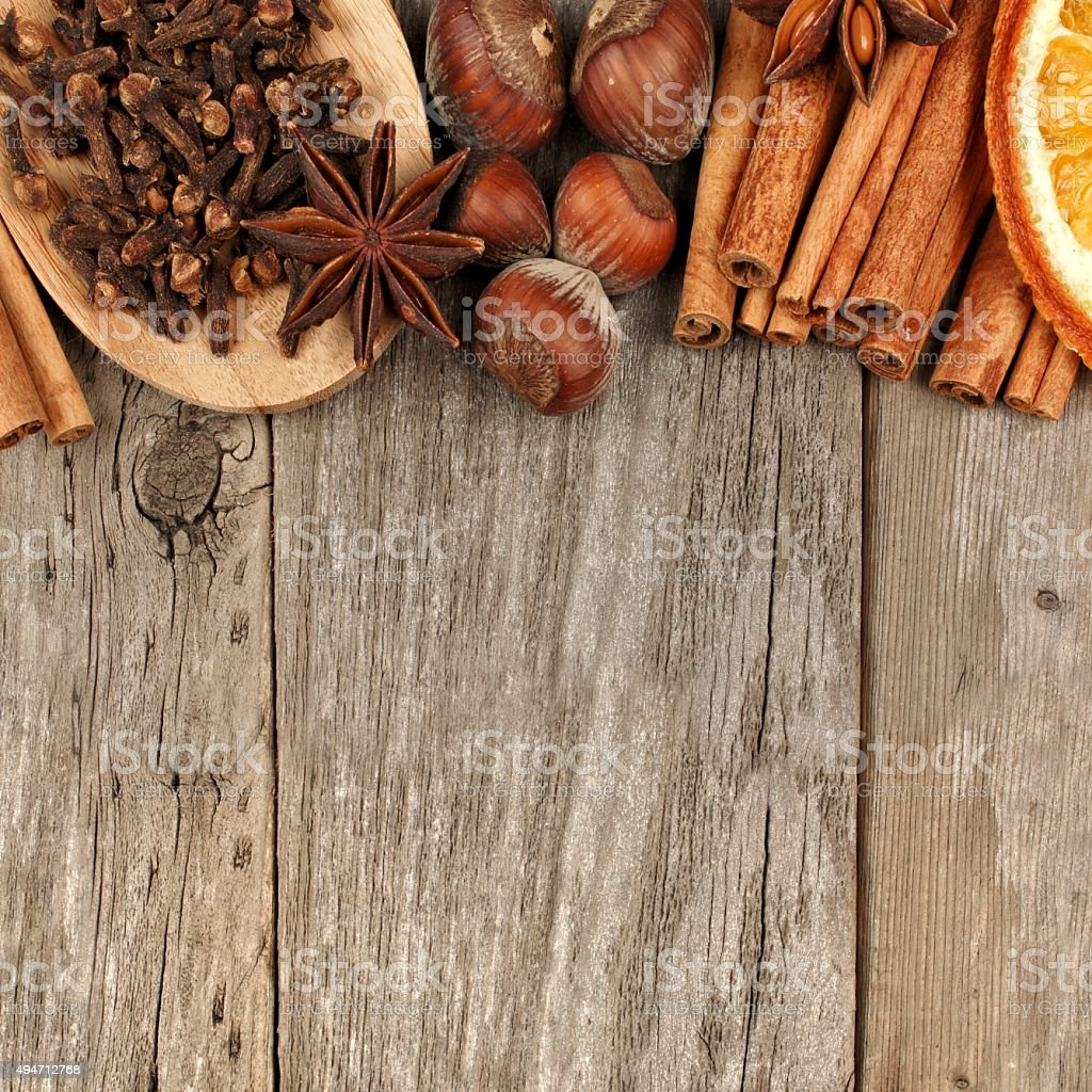 Border of baking ingredients and holiday spices over rustic wood stock photo
