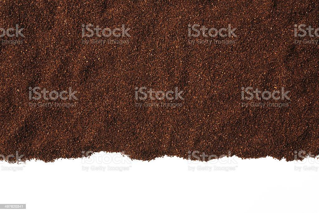 Border of ground coffee beans on white background stock photo