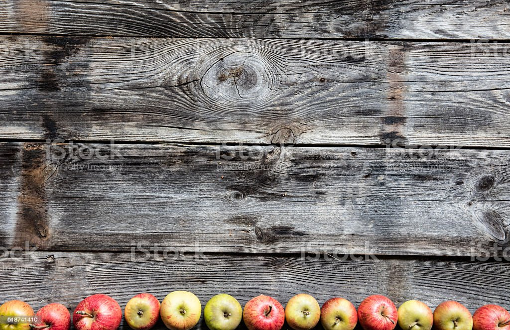 border of organic apples on old genuine wood, flat lay stock photo
