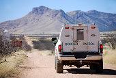 Border patrol truck with Arizona mountains