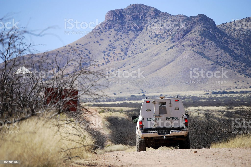 Border patrol truck with mountains stock photo