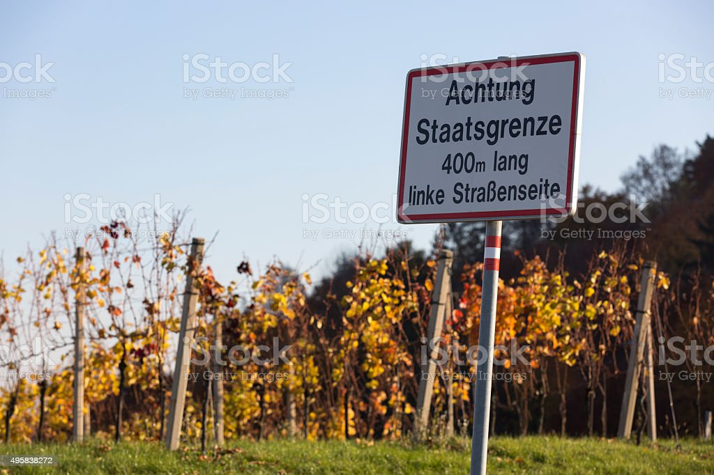 border sign in southern styria, austria.area called südsteirische weinstraße stock photo
