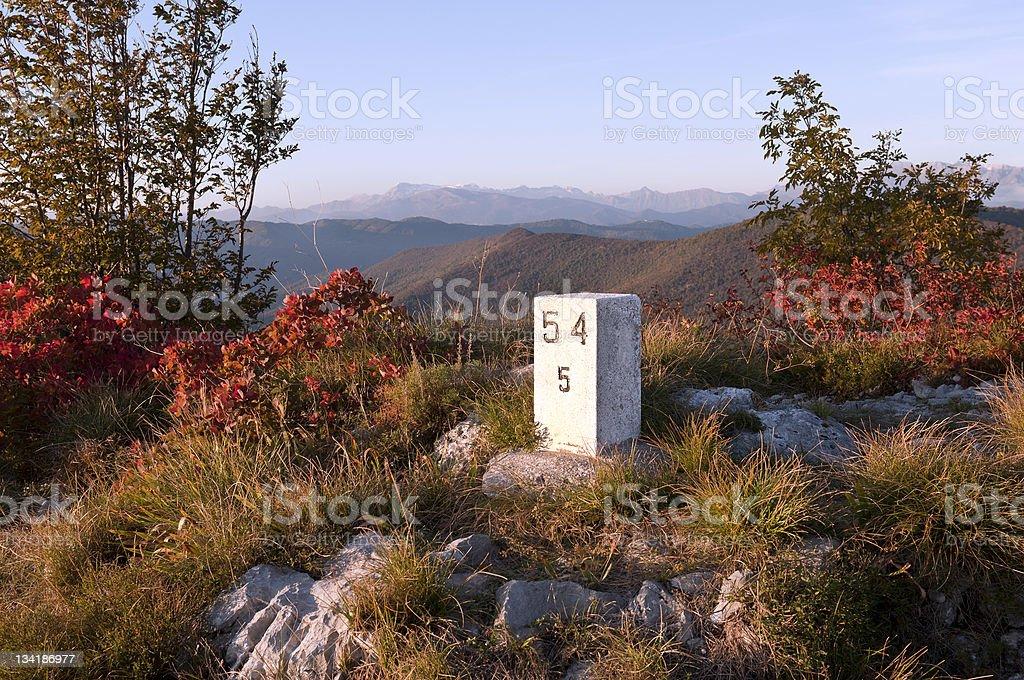 Border Stone between Slovenia and Italy on Hill Sabotin royalty-free stock photo