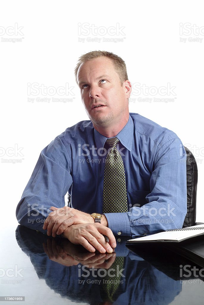 Bored and Frustrated Businessman Sitting at his Desk royalty-free stock photo