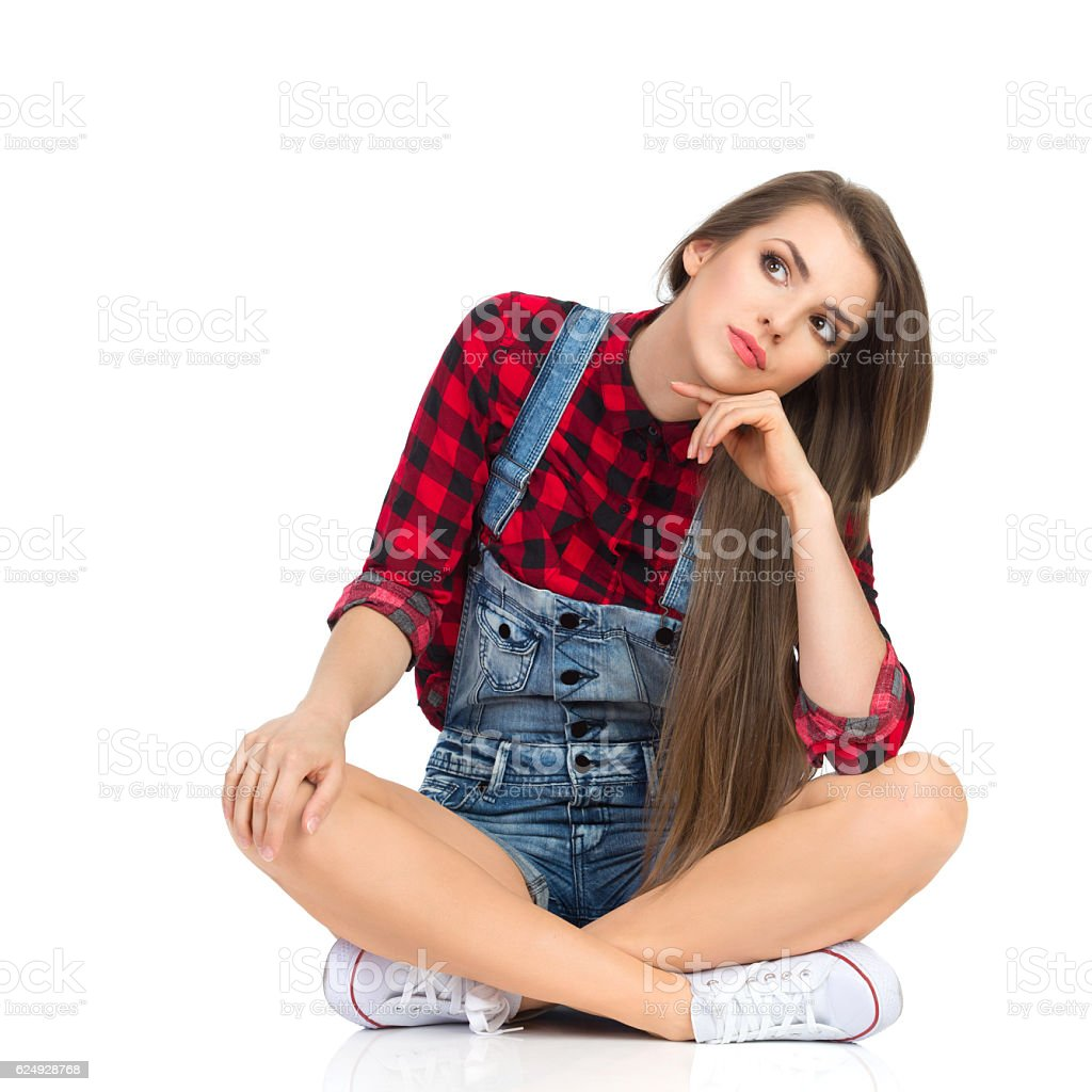 Bored And Sad Woman Sitting With Legs Crossed stock photo