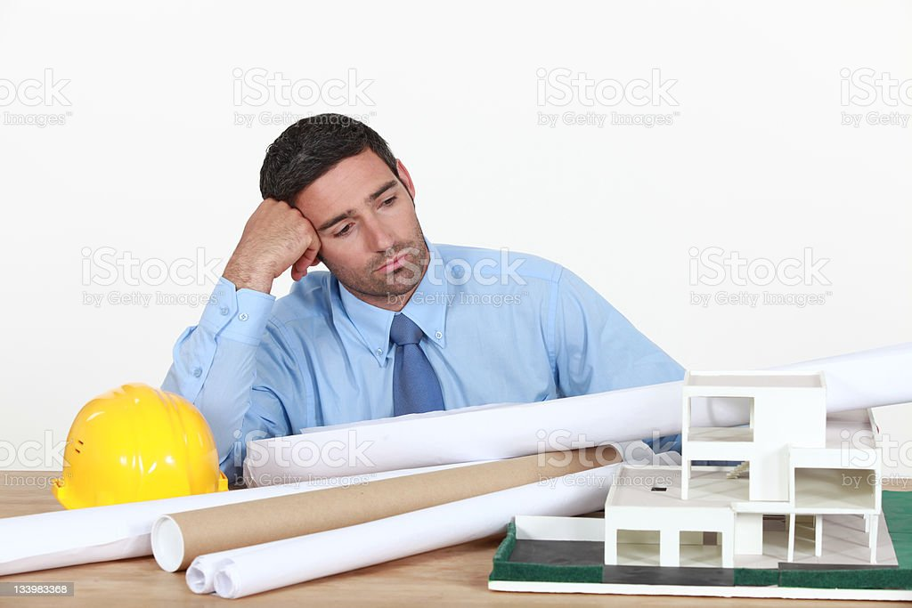 Bored architect at his desk. royalty-free stock photo