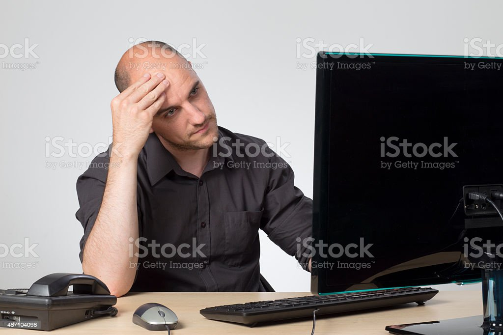 Bored at work stock photo