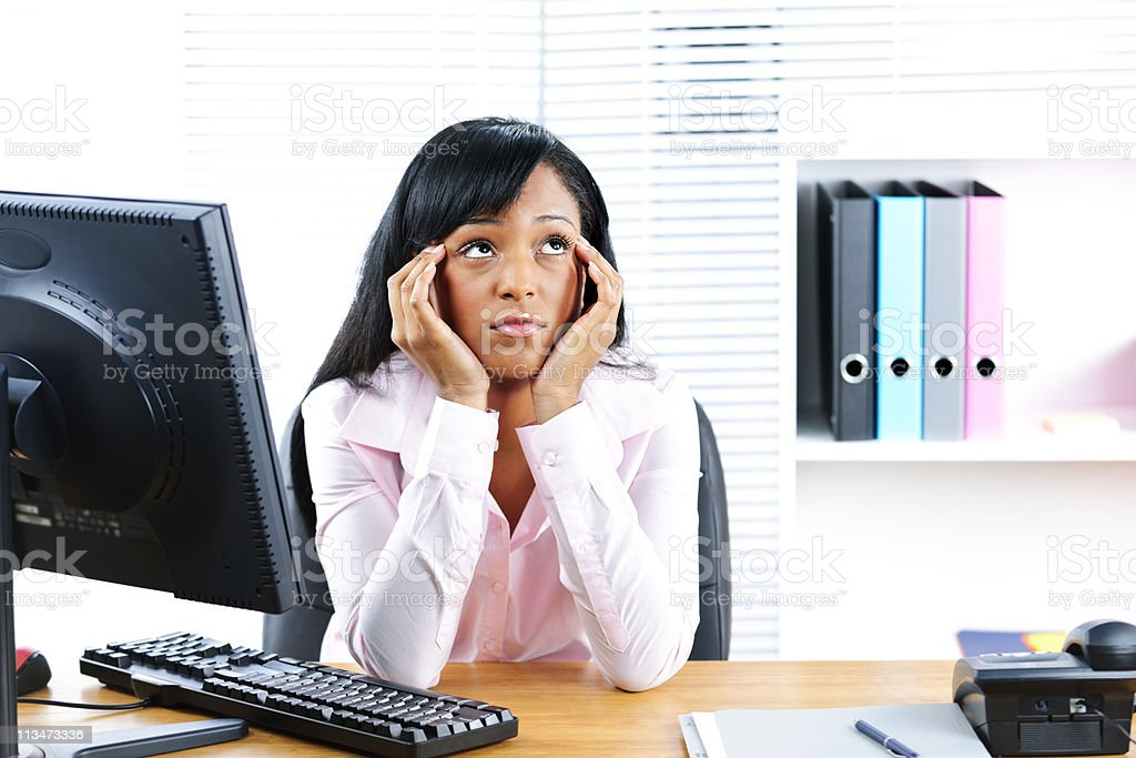 Bored black businesswoman in office stock photo