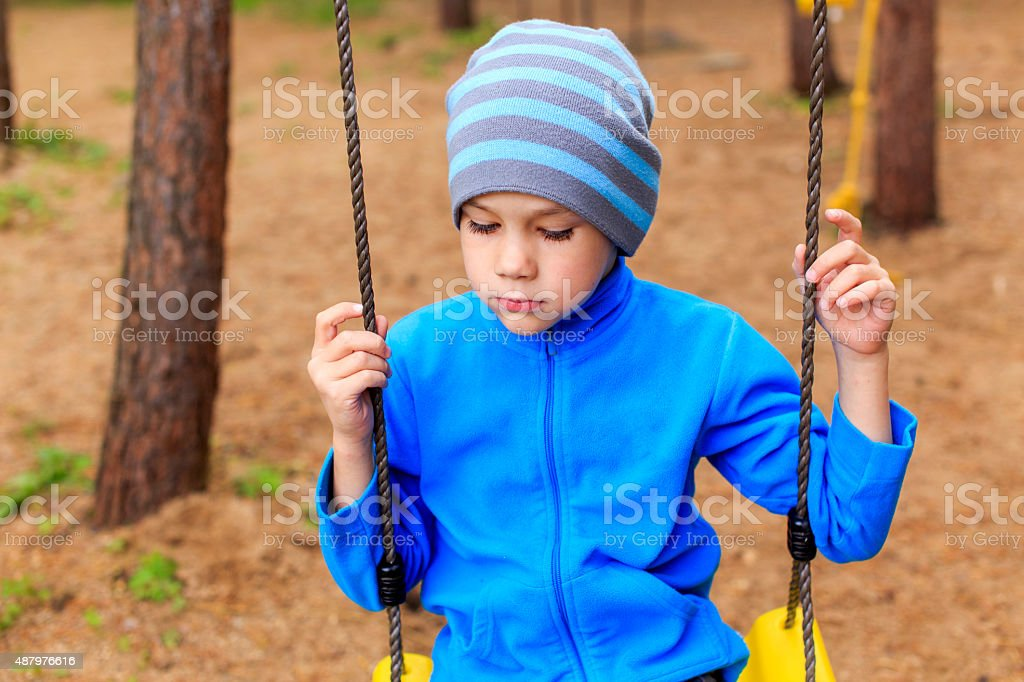 bored boy in the park stock photo