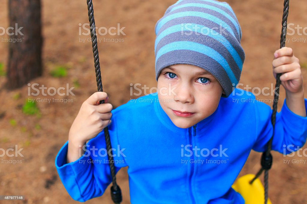 Bored boy with no friends stock photo
