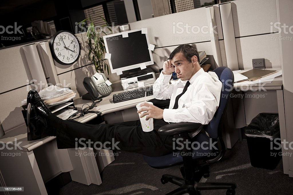Bored Business Man thinking in Office Cubicle stock photo