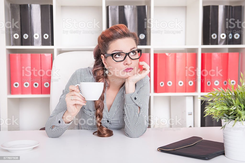Bored business woman working. Overwork concept stock photo