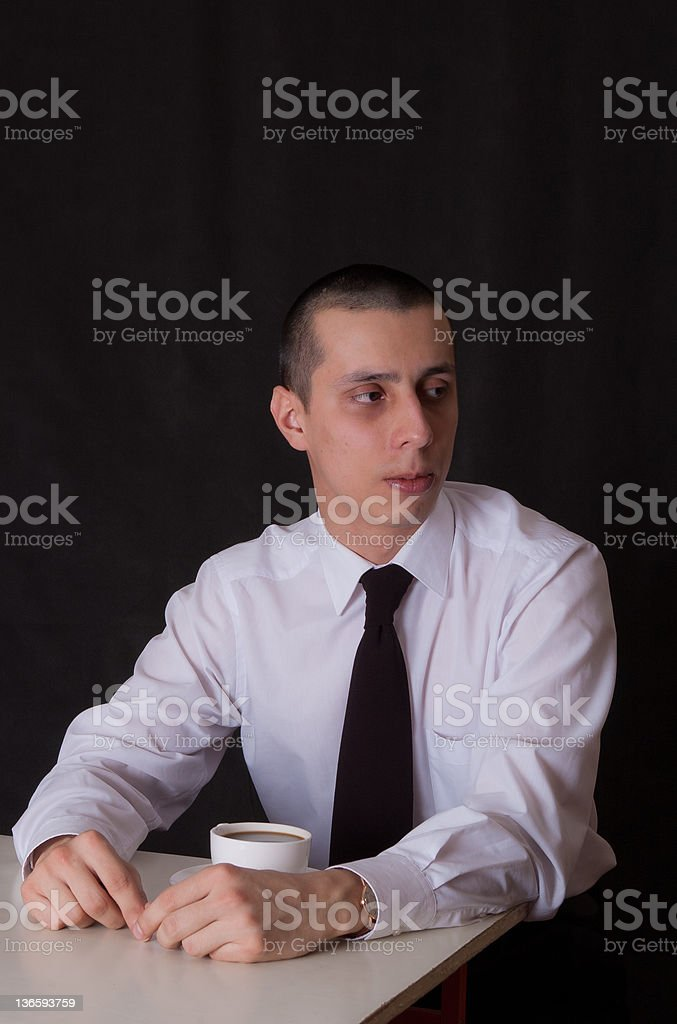 bored businessman drinking coffee royalty-free stock photo