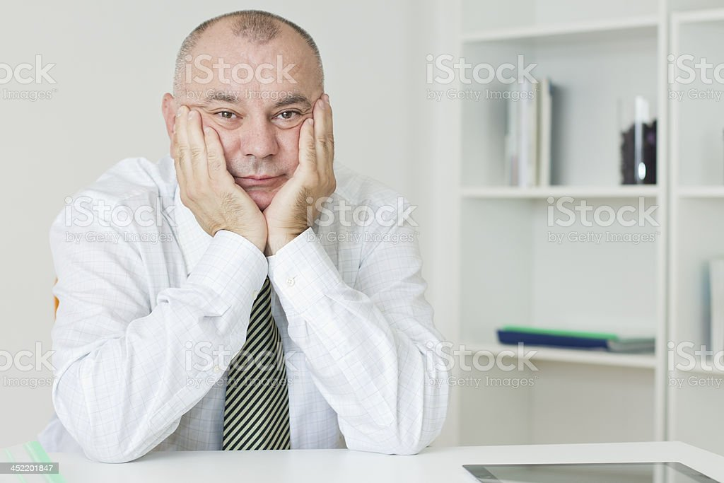 Bored businessman in white office stock photo