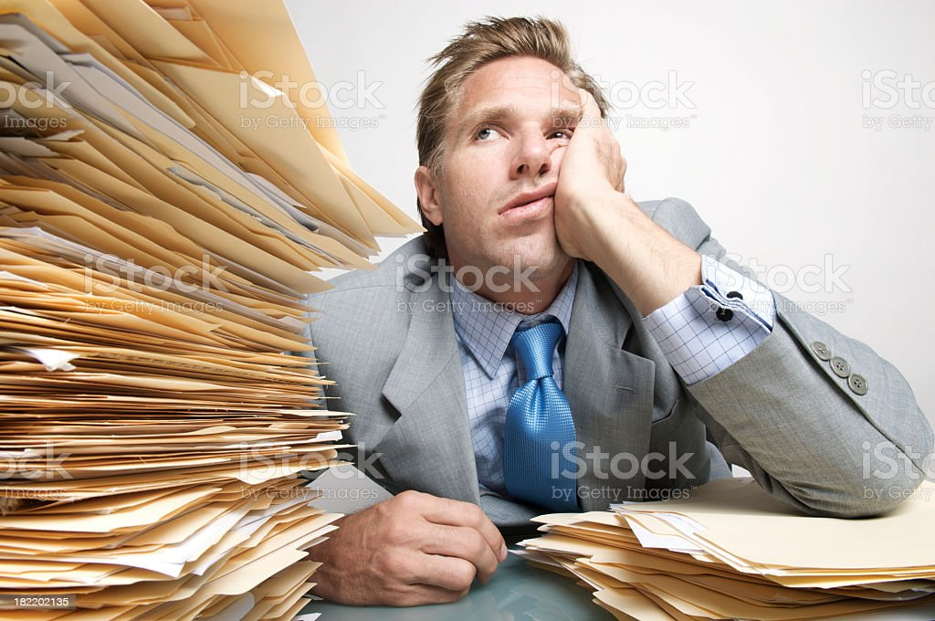 Bored Businessman Office Worker Looking at Stack of Paperwork Inbox royalty-free stock photo