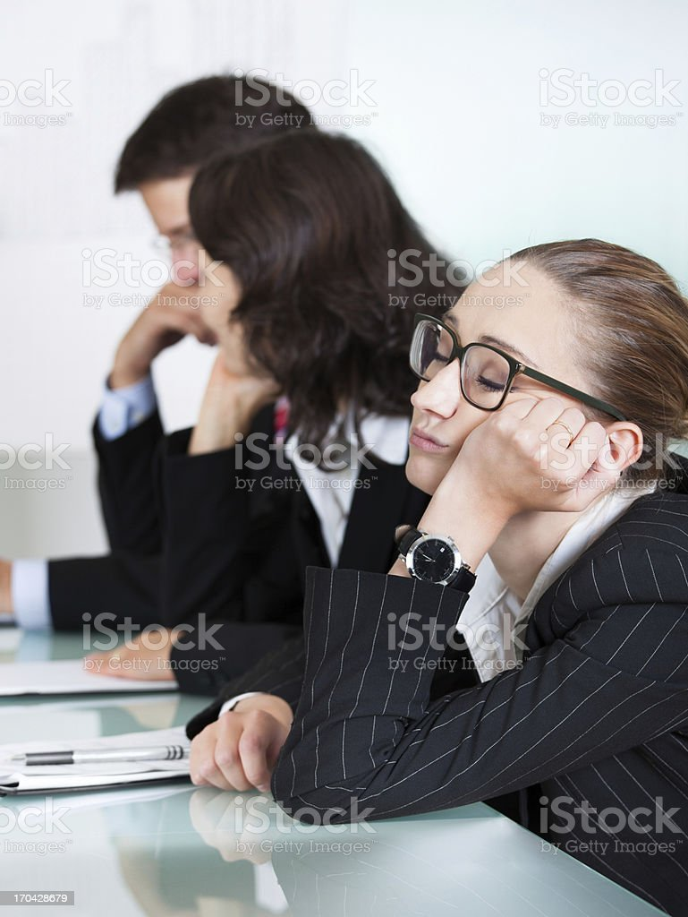 Bored businesswoman sleeping in a meeting royalty-free stock photo