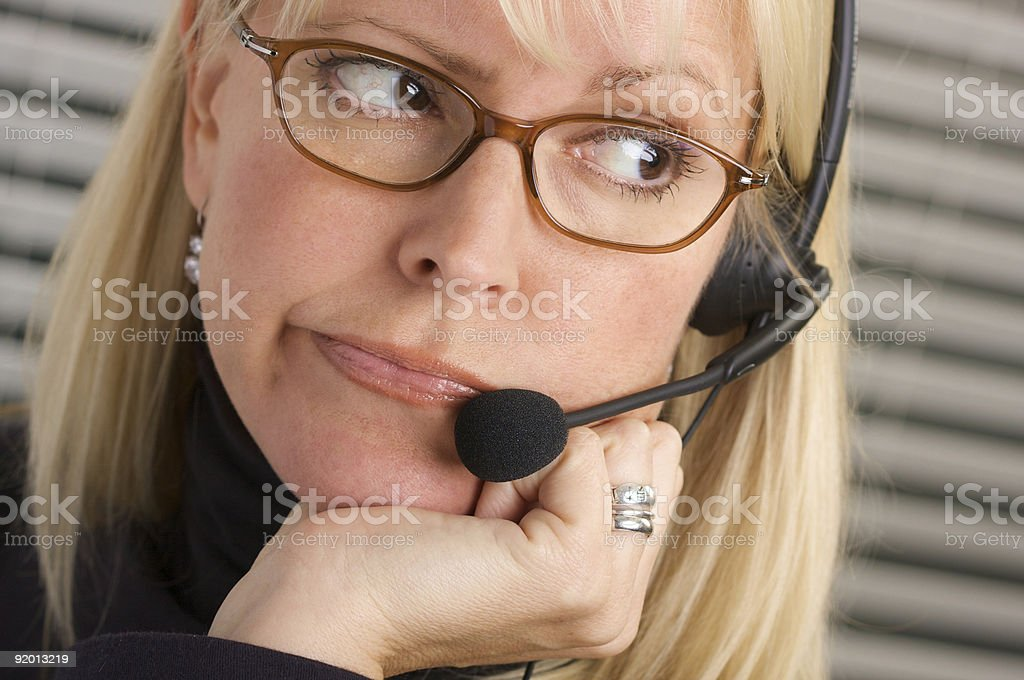 Bored Businesswoman With Phone Headset royalty-free stock photo