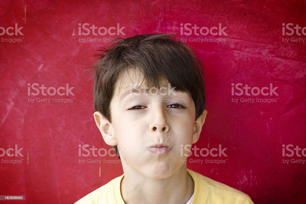 Bored Child Portrait on Red Background royalty-free stock photo