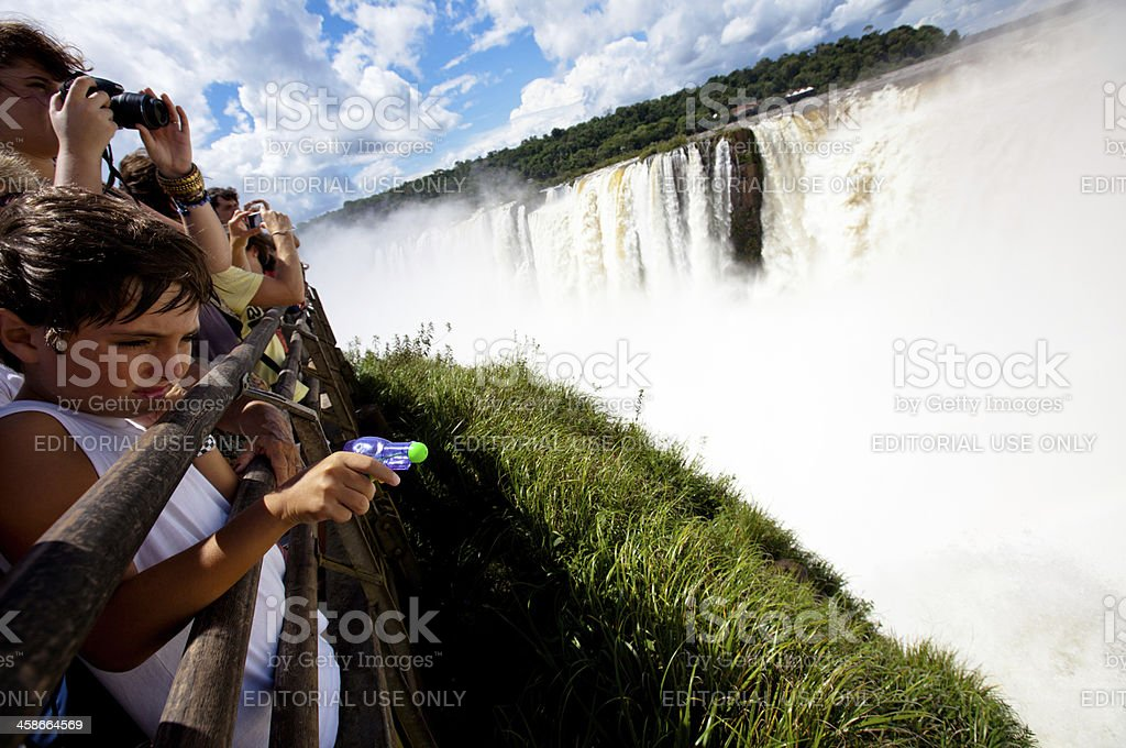 Bored child tourist at Iguazu falls royalty-free stock photo