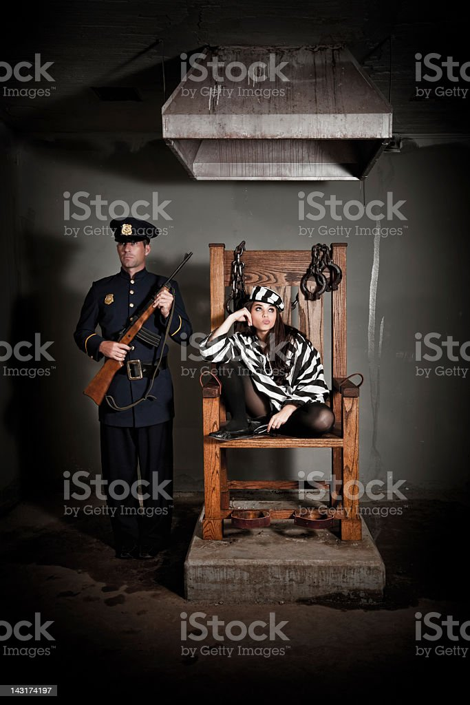 Bored Female Prisoner in Electric Chair stock photo