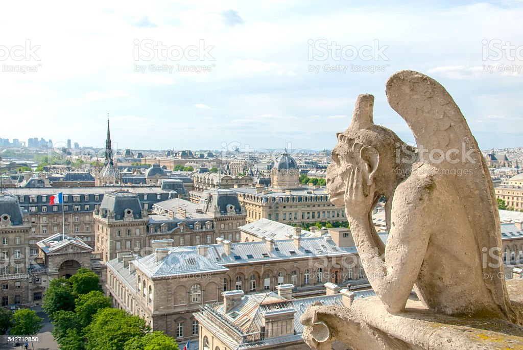 Bored Gargole of Notre Dame II. stock photo