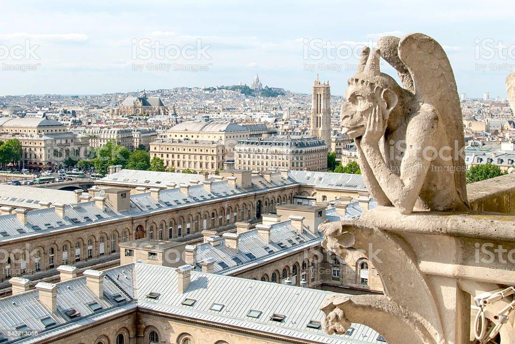 Bored Gargole of Notre Dame. stock photo