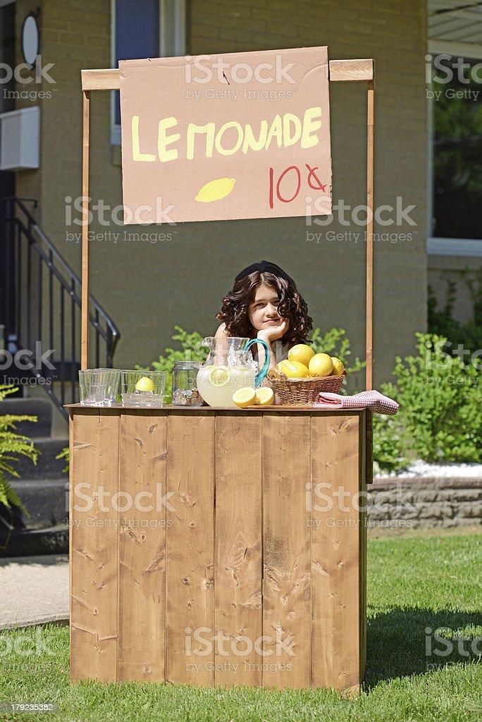bored girl at lemonade stand royalty-free stock photo