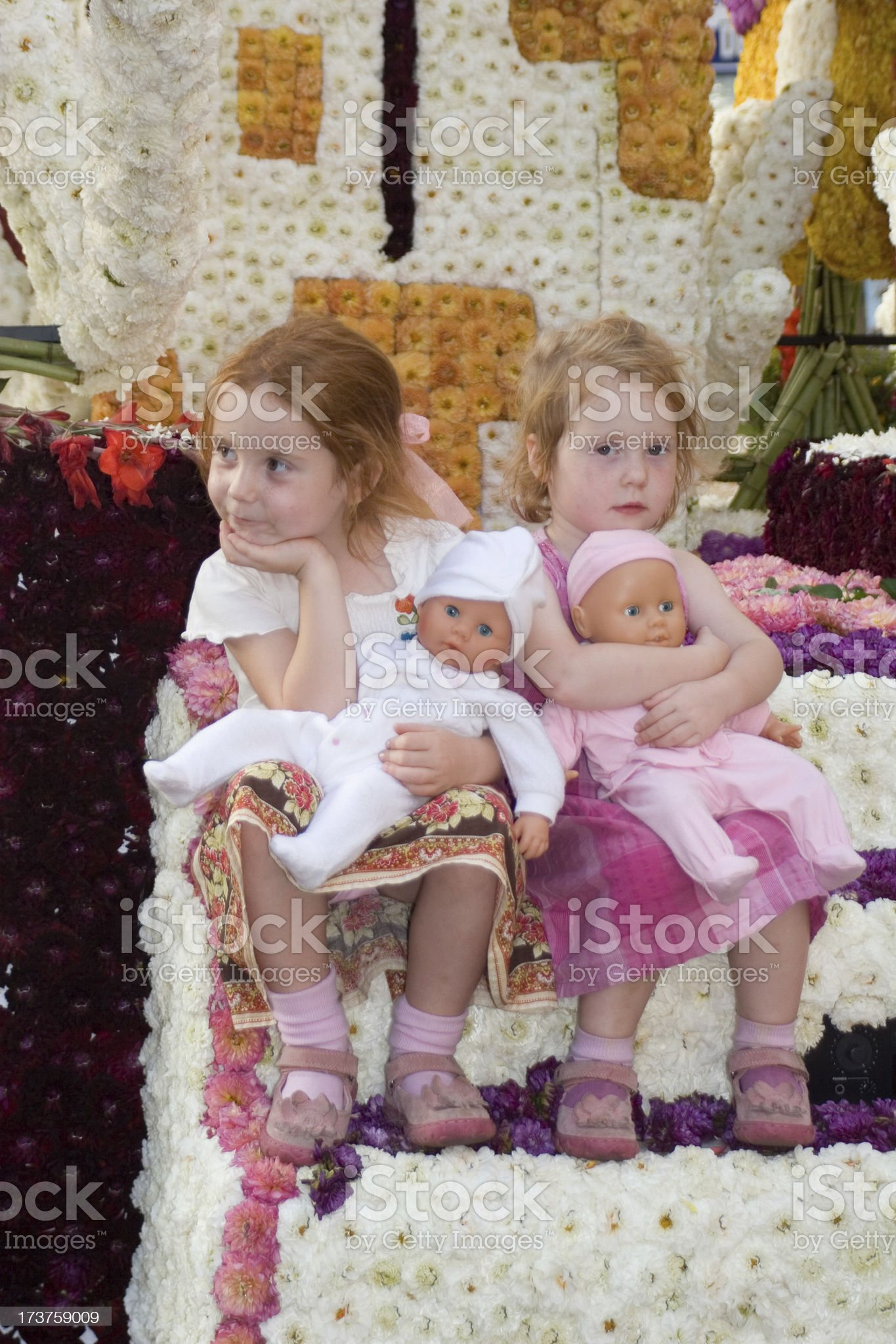 Bored girls on flower parade wagon royalty-free stock photo